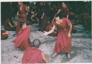 Monk dramatic hand slapping